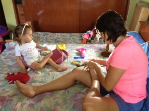 Adri and mommy doing their toes