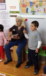 Santi singing along with the music teacher