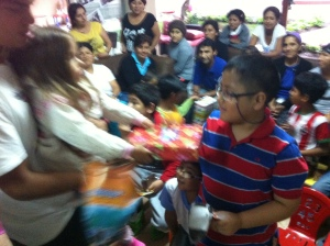 Adri distributing gifts