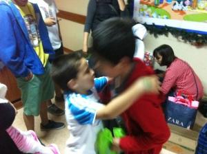 Santi distibuting hugs